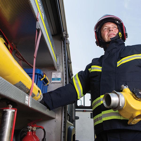 Firefighter near fire truck